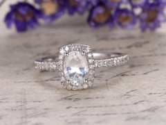 DUPUY  5x7mm Oval  white Sapphire engagement ring