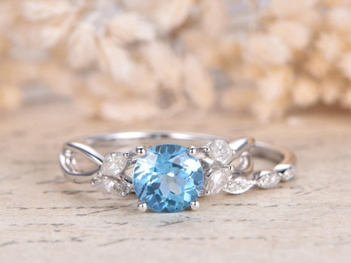 DUPUY 7mm Oval Cut Sky Blue Topaz Ring  Split Shank Band