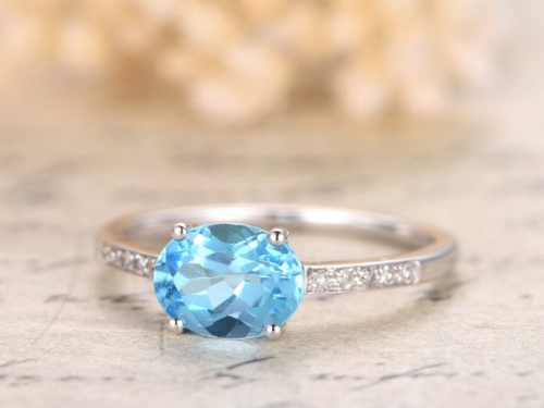 DUPUY 6x8mm Oval Sky Blue Topaz Engagement Ring